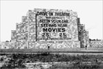 12 Jun 1933, Camden, New Jersey, USA --- 6/12/1933-Camden, NJ- Back view of a huge drive-in movie screen -- a wall with advertisement and admission prices. --- Image by © Bettmann/CORBIS